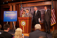 12 Jul 2012 --- Al Franken speaking at a US Senate press conference about the Disclose Act, with l-r- Senators Jeanne Shaheen, Sheldon Whitehouse, Jeff Merkley - the act concerns the disclosure of the names of persons and organizations giving more than $10000 to a PAC or for ad campaigns --- Image by © Owen Franken/Corbis