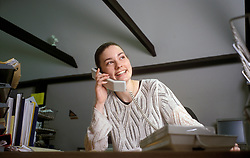 Trainee office worker on the telephone UK