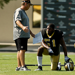 July 31, 2010; Metairie, LA, USA; New Orleans Saints defensive coordinator Gregg Williams talks with linebacker Jonathan Vilma (51) during a training camp practice at the New Orleans Saints practice facility. Mandatory Credit: Derick E. Hingle