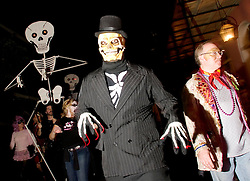 October 31, 2005. New Orleans, Louisiana. <br /> Halloween, post Katrina, New Orleans. As the city returns to a strange sense of normalcy and the citizens return, New Orleans once again hosts a Halloween parade and party. The parade makes its way down Bourbon Street. Photo; ©Charlie Varley/varleypix.com