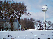 """25 FEBRUARY 2020 - BUTTERFIELD, MINNESOTA: The water tower of the edge of town in Butterfield, MN, a farming community of about 500 people 130 miles southwest of the Twin Cities. The town has been a """"food desert"""" for 10 years after its only grocery store closed in 2010. Barb Mathistad Warner and Mark Warner purchased the True Value store in Butterfield in December, 2018 and started selling groceries in the store in May, 2019. For residents of Butterfield going to a grocery store meant driving 10 miles to St. James, MN, or 20 miles to Windom, MN, the two nearest communities with grocery stores. The USDA defines rural food deserts as having at least 500 people in a census tract living 10 miles from a large grocery store or supermarket. There is a convenience store in Butterfield, but it sells mostly heavily processed, unhealthy snack foods that are high in fat, sugar, and salt.   PHOTO BY JACK KURTZ"""