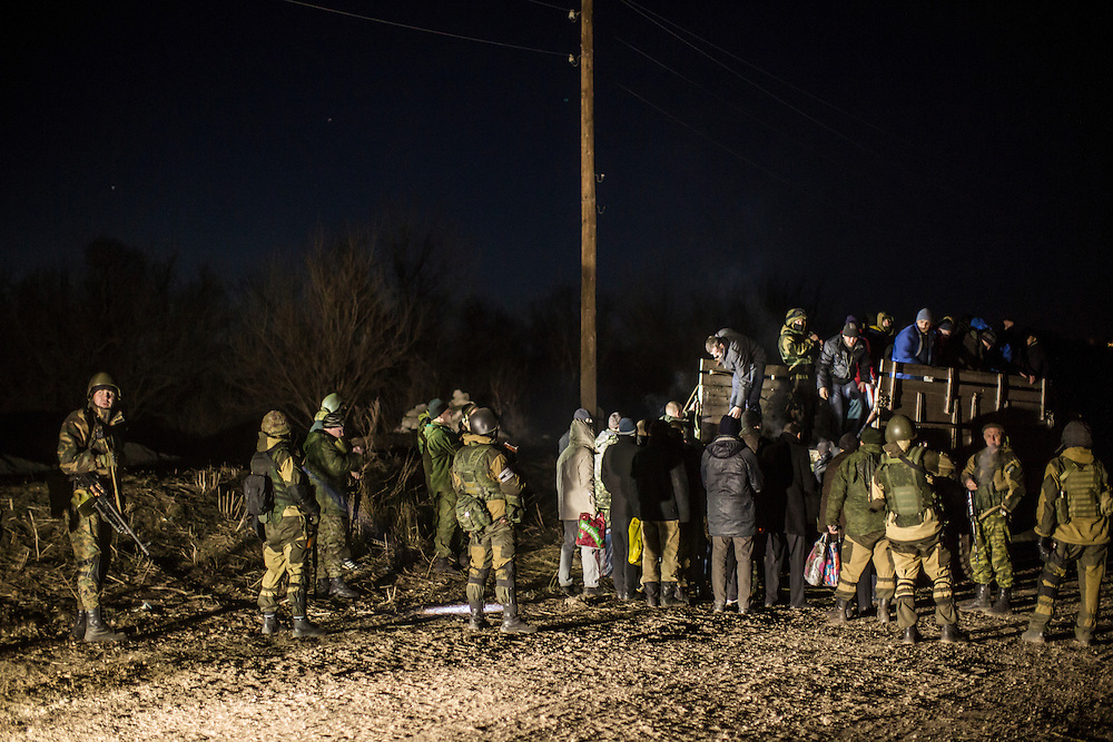NOVOTOSHKIVSKE, UKRAINE - FEBRUARY 21: Ukrainian prisoners of war are loaded onto a truck by pro-Russian rebels for transport to a prisoner exchange on February 21, 2015 in Novotoshkivske, Ukraine. Ukrainian forces withdrew from the strategic and hard-fought town after being effectively surrounded by pro-Russian rebels, though fighting has caused widespread destruction.