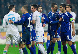 Tim Matavz of Slovenia in fight with Emir Spahic (#4) of BIH during friendly football match between National teams of Slovenia and Bosna and Herzegovina, on February 6, 2013 in SRC Stozice, Ljubljana, Slovenia. BIH defeated Slovenia 3-0. (Photo By Vid Ponikvar / Sportida.com)