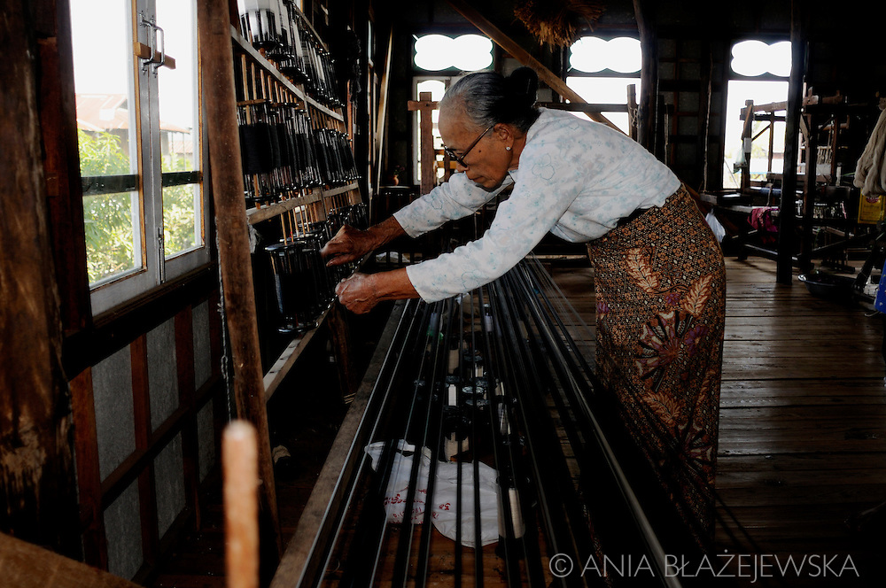 Burma/Myanmar. Woman working in the traditional weaving workshop.
