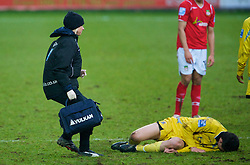 WREXHAM, WALES - Saturday, February 14, 2009: Grays Athletic's blonde physio Becky Nutt treats injured player George Beavan during the Blue Square Premier League match against Wrexham at the Racecourse Ground. (Mandatory credit: David Rawcliffe/Propaganda)