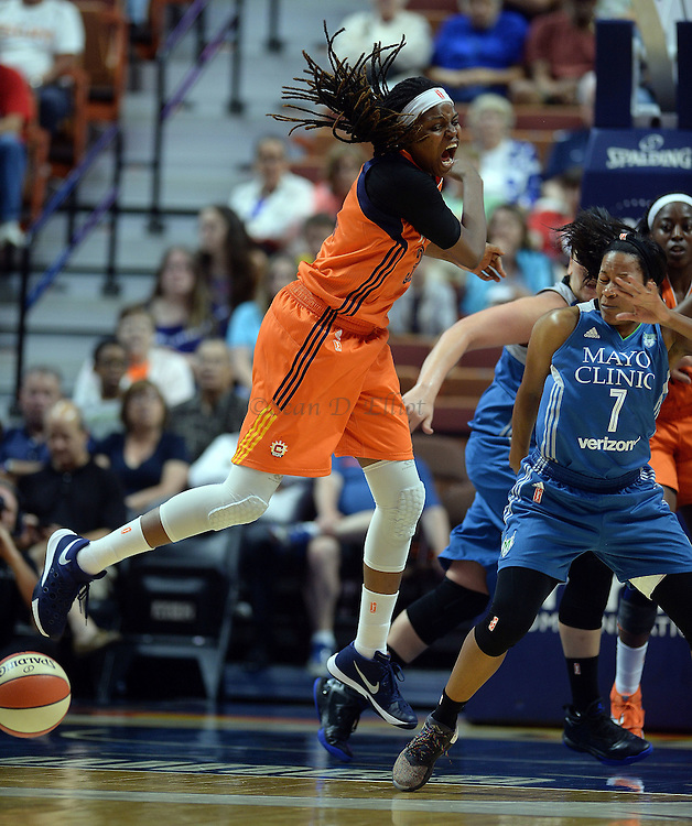 7/7/16 :: SPORTS :: GRIFFEN :: Connecticut's Jonquel Jones knocks the ball away from Minnesota's Jia Perkins (7) in WNBA action Thursday, July 7, 2016 at Mohegan Sun Arena. (Sean D. Elliot/The Day)