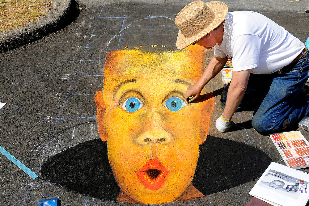 H:\EDITORIAL\Photos\04April 09\JH 4-30-09  POP UP ARTóArtist Matt Oppenheimer of Camarillo draws side chalk art of a face popping up out of the ground in the Moorpark Civic Center parking lot at the Moorpark Arts Festival at the on Sunday, April 26 in Moorpark. The drawing is created in perspective for a child's height.