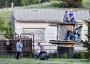 Kids play around the storage shed and a top of wooden spools during the Wessington Springs Foothills Rodeo at the Jerauld County 4-H Grounds. (Matt Gade / Republic)