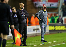 WIGAN, ENGLAND - Monday, February 19, 2018: Wigan Athletic's manager Paul Cook and Manchester City's manager Pep Guardiola during the FA Cup 5th Round match between Wigan Athletic FC and Manchester City FC at the DW Stadium. (Pic by David Rawcliffe/Propaganda)