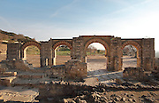 The Great Portico, a horseshoe arch and 3 remaining Roman arches striped with red brick, at the Palace of Madinat az-Zahra, a royal palace built 936-945 by Abd-ar-Rahman III al-Nasir, 912ñ961, Umayyad Caliph of Cordoba, outside Cordoba, Andalusia, Southern Spain. The complex was extended under Al-Hakam II, 961-976, and sacked and abandoned in 1010. Picture by Manuel Cohen