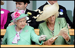 HM The Queen and The Duchess of Cornwall look at horses in the parade ring from the royal box at Royal Ascot 2013<br /> Ascot, United Kingdom<br /> Wednesday, 19th June 2013<br /> Picture by Andrew Parsons / i-Images
