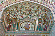 Islamic design of Ganesh Pol, Ganesh Gate, at The Amber Fort a Rajput fort built 16th Century in Jaipur, Rajasthan, Northern India