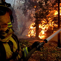 The Grass Valley Fire ravages its way into the Lake Arrowhead area of  Grass Valley Lake and The Lake Arrowhead Country Club as firefighters from all over the inland empire attack fire and defend homes, Oct. 22, 2007. Eric Reed Photographer