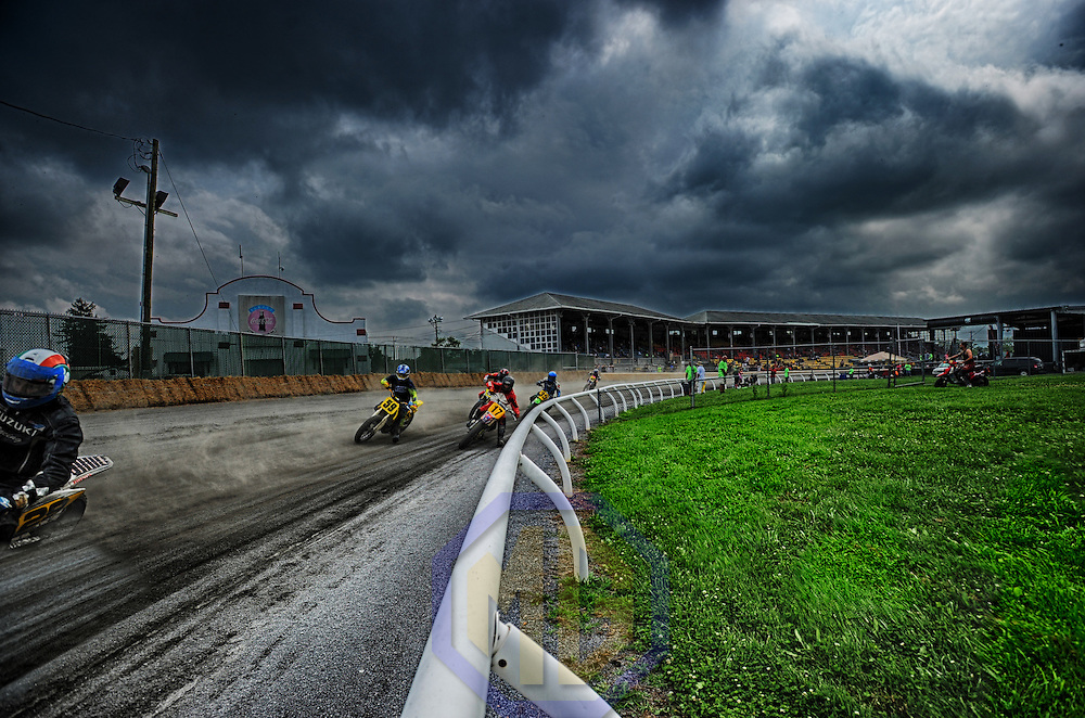 04 July 2015:  A 15 frame High Dynamic Range (HDR) image of motorcycle riders competing in the 93rd running of  the Barabara Fritchie Classic on the oldest running half mile Dirt Track race in America at the Frederick County Fairgrounds on July 4, 2015 in Frederick, MD. (Photograph by Mark Goldman/Goldminephotos)