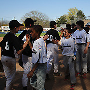 Young baseball players congratulate each other after the ball game during the Norwalk Little League baseball competition at Broad River Fields,  Norwalk, Connecticut. USA. Photo Tim Clayton