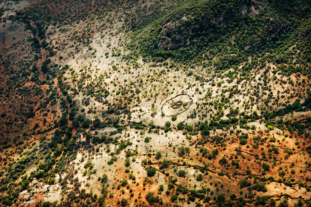 Flying over the Samburu region of north-central Kenya, the outlines of bomas are clearly visible.