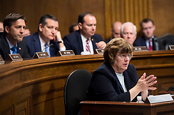 September 27, 2018 - Washington, District of Columbia, U.S. - RACHEL MITCHELL, counsel for Senate Judiciary Committee Republicans, questions Dr. Ford as Senators, from left, BEN SASSE, R-Neb., TED CRUZ, R-Texas, MIKE LEE, R-Utah.,  and JOHN CORNYN, R-Texas, listen during the Senate Judiciary Committee hearing on the nomination of Judeg Kavanaugh to be an associate justice of the Supreme Court of the United States, focusing on allegations of sexual assault by Kavanaugh against Christine Blasey Ford in the early 1980s. (Credit Image: © Tom Williams/Pool via ZUMA Wire)