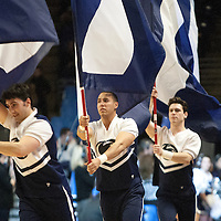 Penn State cheerleaders run onto the court carrying flags before the start of an NCAA basketball game in Unversity Park, Pa., Wedneday, February 27, 2013.