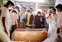 Mourners gather at the Soviet Friendship Hospital morgue claiming loved ones and preparing the dead to be sent out to their home province, in Phnom Penh, Cambodia, on Tuesday, Nov. 23, 2010. Nearly 375 festival goers died in a stampede on the Diamond Gate bridge on the last day of the three-day annual Water Festival.