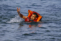 A refugee swims to the shore of Lesbos after he jumped off from the boat carrying them. Hundreds of refugees, mainly from Syria, Iraq and Afghanistan are still coming to the Greek island of Lesbos on a daily basis, after making the dangerous trip from the nearby Turkish coast in small inflatable boats. lesbos, Greece, September 9, 2015. Photo by Michael Debets/Pacific Press/ABACAPRESS.COM  | 515147_001 Lesbos Grèce Greece