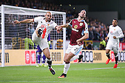 Watford midfielder Nordin Amrabat (7)  clears the ball ahead of Burnley midfielder George Boyd (21)  during the Premier League match between Burnley and Watford at Turf Moor, Burnley, England on 26 September 2016. Photo by Simon Davies.
