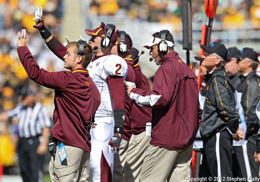 September 22 2012: Central Michigan Chippewas head coach Dan Enos stands behind his signal callers during the second half of the NCAA football game between the Central Michigan Chippewas and the Iowa Hawkeyes at Kinnick Stadium in Iowa City, Iowa on Saturday September 22, 2012. Central Michigan defeated Iowa 32-31.