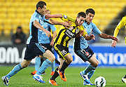Phoenix's Louis Fenton splits the Sydney defense. A-League football - Wellington Phoenix v Sydney FC at Westpac Stadium, Wellington, New Zealand on Saturday 6 October 2012. Photo: Justin Arthur / Photosport.co.nz