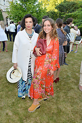 Left to right, BIANCA JAGGER and AYESHA SHAND at the Quintessentially Foundation and Elephant Family 's 'Travels to My Elephant' Royal Rickshaw Auction presented by Selfridges and hosted by HRH The Prince of Wales and The Duchess of Cornwall held at Lancaster House, Cleveland Row, St.James's, London on 30th June 2015.
