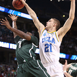Mar 17, 2011; Tampa, FL, USA; UCLA Bruins forward Brendan Lane (21) blocks a shot by Michigan State Spartans guard Kalin Lucas (1) during the first half of the second round of the 2011 NCAA men's basketball tournament at the St. Pete Times Forum.  Mandatory Credit: Derick E. Hingle