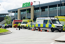 A Chemical spill in an Asda Superstore Car Park at Chaucer Road, Parson Cross, Sheffield resulted in customers being evacuated, road closures and some customers being sent home in Taxis. <br /> The incident was attended by Police, Firefighters, Decontamination Support and Ambulance crews on Friday Afternoon<br /> <br /> 29 May 2015<br />  Image © Paul David Drabble <br />  www.pauldaviddrabble.co.uk