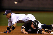 5/29/08 -- ST. PETERSBURG -- White Sox third baseman Joe Crede tries to get back to second base after breaking up the double play from Rays second baseman Akinori Iwamura in the fourth inning on May 29, 2008.