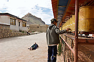 Tibetans spend most of their free time walking around holy monuments.  Sometimes, they do prostrations every three steps as they circle.   They might do this for months or years one end to build karma credits and ensure a good rebirth in the next life.  (Kumbum Monestary, Gyantse)