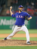 March 26, 2018 - Arlington, TX, U.S. - ARLINGTON, TX - MARCH 26: Texas Rangers relief pitcher Chris Martin (31) comes on to pitch during the exhibition game between the Cincinnati Reds and Texas Rangers on March 26, 2018 at Globe Life Park in Arlington, TX. (Photo by Andrew Dieb/Icon Sportswire) (Credit Image: © Andrew Dieb/Icon SMI via ZUMA Press)