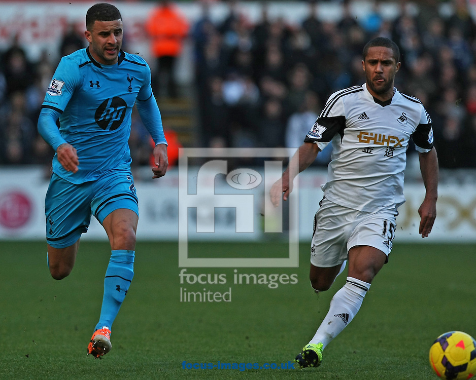 Picture by Mark Hawkins/Focus Images Ltd 07949 023795<br /> 19/01/2014<br /> Kyle Walker of Tottenham Hotspur and Wayne Routledge of Swansea City during the Barclays Premier League match at the Liberty Stadium, Swansea.