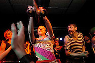 2/20/05-Washington, DC--Ukrainian rock sensation, Gogol Bordello performs to a sold out show at the Black Cat. Led by Ukrainian immigrant Eugene Hutz, the band blends Gypsy culture, theatrical stage art and punk rock..Photo by Ryan K Morris...