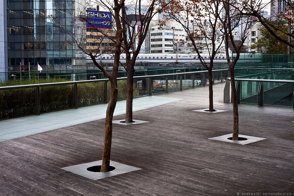 Overground deck in Shimbashi area of Tokyo. In the back the bullet train (shinkansen) can be seen running