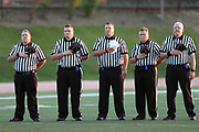 Officials stand during the playing of the National Anthem at the Erie Cathedral Prep Ramblers 2017 high school football game against the against the Cleveland Benedictine Bengals, Friday, Sept. 15, 2017 in Erie, Pa. The Ramblers won the game 62-28. (©Paul Anthony Spinelli)