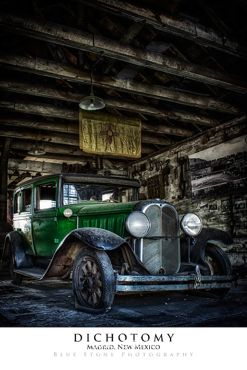 20x30 poster print of antique automobile inside a wooden structure.