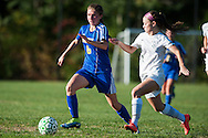 Milton's Taylor Quintin (6) runs down the field with the ball past Rice's Haley Mitiguy (1) during the girls soccer game between the Milton Yellowjackets and the Rice Green Knights at Rice Memorial High School on Saturday afternoon October 3, 2015 in South Burlington. (BRIAN JENKINS/ for the FREE PRESS)