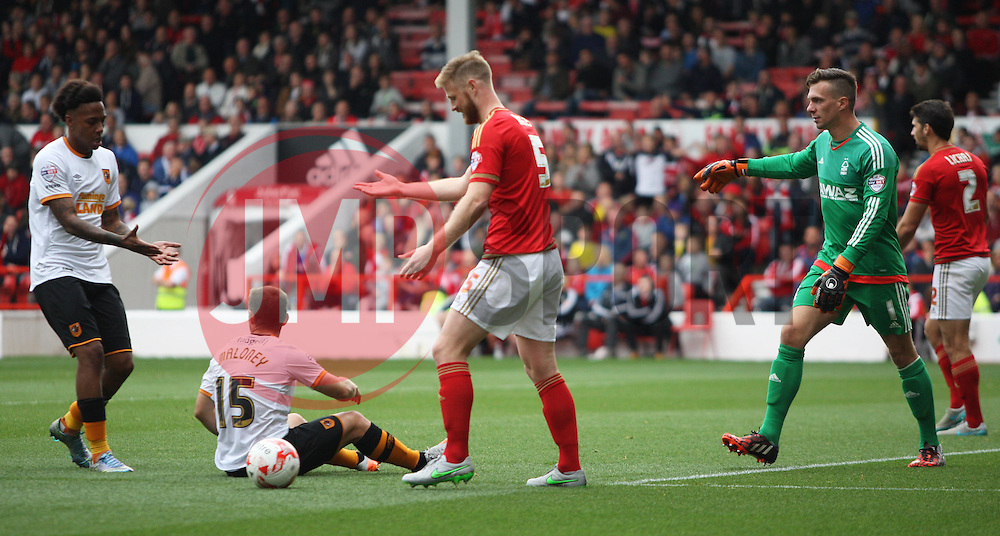Matthew Mills of Nottingham Forest (C) after conceding a penalty - Mandatory byline: Jack Phillips / JMP - 07966386802 - 3/10/2015 - FOOTBALL - The City Ground - Nottingham, Nottinghamshire - Nottingham Forest v Hull City - Sky Bet Championship