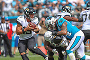Sunday, October 6, 2019; Charlotte, N.C., USA;  Jacksonville Jaguars quarterback Gardner Minshew (15) runs with the ball while running back Leonard Fournette (27) blocks the oncoming Carolina defender during an NFL game at Bank of America Stadium. The Carolina Panthers beat the Jacksonville Jaguars 34-27. (Brian Villanueva/Image of Sport)