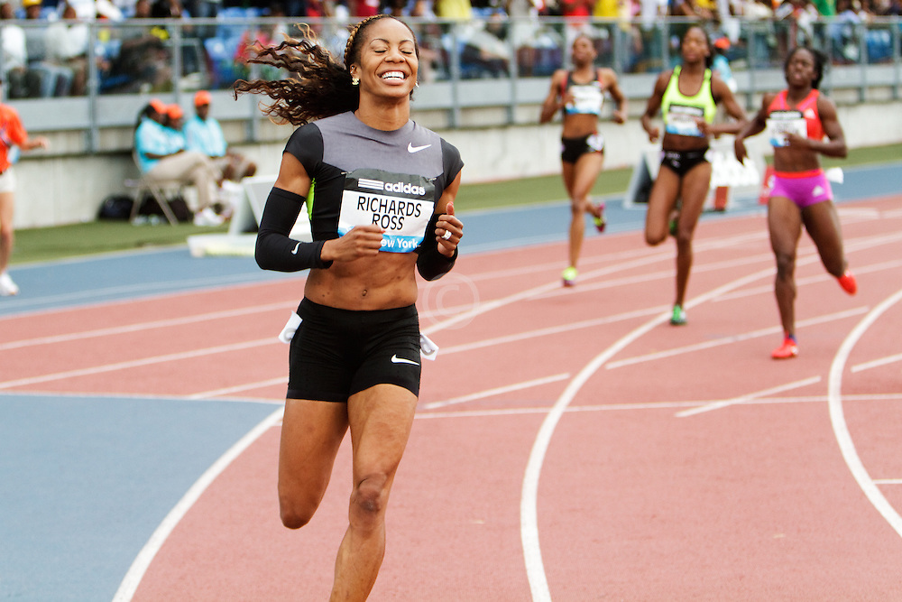 women's 200 meters, Sanya Richards-Ross, USA,  smiles as she wins