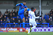 Ethan Ebanks-Landell fouls and gets a yellow card for a high challenge during the EFL Sky Bet League 1 match between Rochdale and Coventry City at Spotland, Rochdale, England on 9 February 2019.