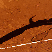 30 May 2009: Shadow of Maria Jose Martinez Sanchez of Spain as she serves during the the Women's Third Round match on day seven of the French Open at Roland Garros in Paris, France.