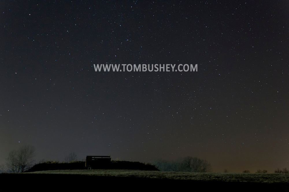 Campbell Hall, New York - Stars shine in the night sky above a farm field on Dec. 14, 2012. ©Tom Bushey / The Image Works