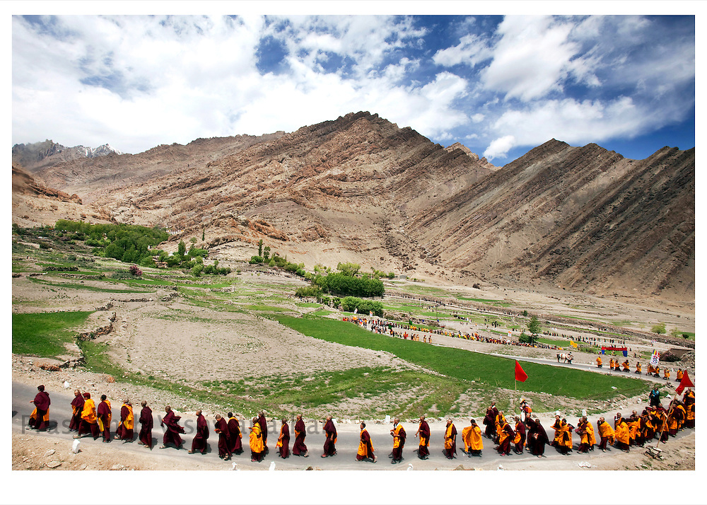 Nuns and monks of the Drukpa lineage undertake a  Pad Yatra (a walking pilrimage) are seen as they approach the Hemis monastery in Leh, Kashmir, India, July 1, 2009. 600 monks and nuns from the Drukpa lineage of Buddhist school of thought led by their spiritual leader the Twelfth Gyalwang Drukpa trekked for 43 days over five high-altitude Himalayan passes in Himachal Pradesh and Ladakh across a 400-km stretch, visiting remote villages to spread awareness about environment, healthcare and the importance of sustainable livelihoods and education. The Nuns and Monks collected pieces of plastics strewn by tourists along the stretch from Manali in Himachal Pradesh to Leh in Kashmir to set an example and promote awareness of the damages caused by plastics to these vast mountain ranges and the water sources they generate. In Bhutan the Drukpa Lineage is the dominant school and state religion..Photographer: Prashanth Vishwanathan.