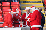 Lincoln City Santas discuss the game during the EFL Sky Bet League 2 match between Crewe Alexandra and Lincoln City at Alexandra Stadium, Crewe, England on 26 December 2018.