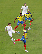 fr119 (L) flicks the ball past Frickson Erazo of Ecuador (c) and Walter Ayovi of Ecuador (r) during the 2014 FIFA World Cup Group E match at Maracana Stadium, Rio de Janeiro<br /> Picture by Andrew Tobin/Focus Images Ltd +44 7710 761829<br /> 25/06/2014