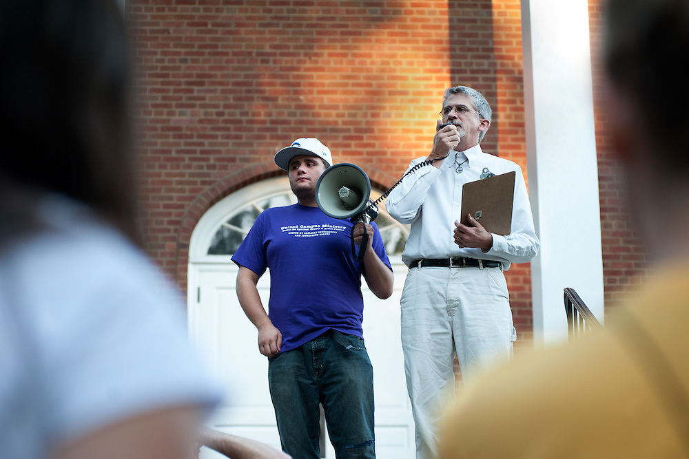UCM campus minister Evan Young (right) talks to the crowd assembled at the Good Shepard Episcopal church before the September 11th Interfaith walk. Young spoke to the crowd about the events of 9/11 and the need for interaith understanding. Photo by: Ross Brinkerhoff