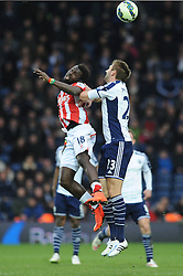 Stoke City's Mame Biram Diouf and West Bromwich Albion's Gareth McAuley challenge for the header  - Photo mandatory by-line: Dougie Allward/JMP - Mobile: 07966 386802 - 14/03/2015 - SPORT - Football - Birmingham - The Hawthorns - West Bromwich Albion v Stoke City - Barclays Premier League